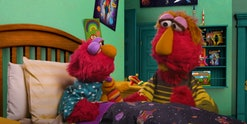 "Elmo and his dad sing ""Feel Better Song."""
