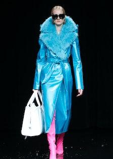 Balenciaga fur-trimmed blue coat.
