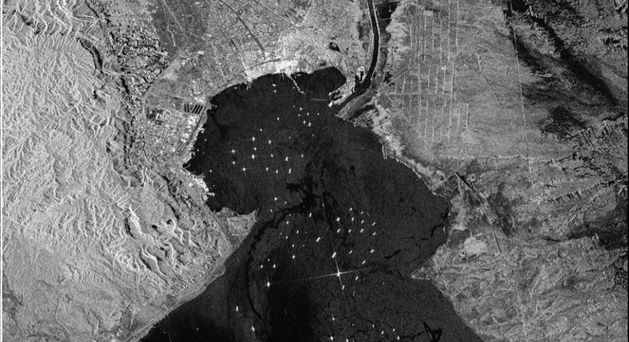 THE ENORMOUS EVER GIVEN CONTAINER SHIP, WEDGED IN EGYPT'S SUEZ CANAL, IS VISIBLE IN NEW IMAGES CAPTURED BY THE COPERNICUS SENTINEL-1 MISSION