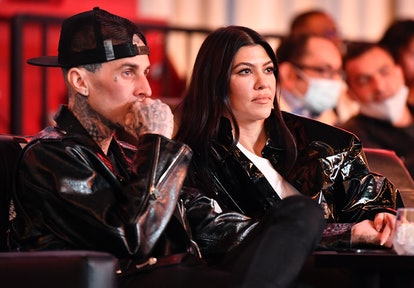 LAS VEGAS, NEVADA - MARCH 27: Travis Barker and Kourtney Kardashian are seen in attendance during the UFC 260 event at UFC APEX on March 27, 2021 in Las Vegas, Nevada.