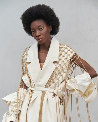 Model wearing a cut-out trench west from Ushatava Spring 2021 collection/campaign.