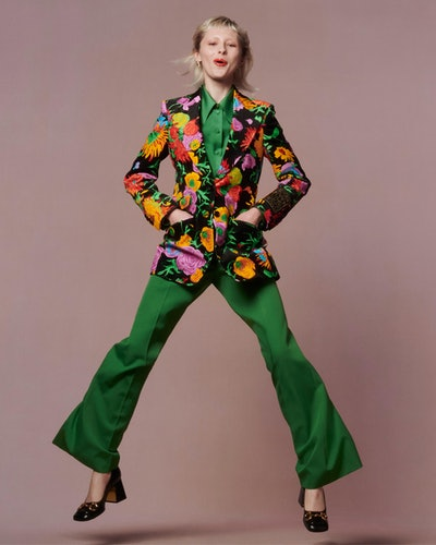 Model wearing a full Gucci green and floral look for Net-a-Porter's Spring/Summer 2021 'Ready To Wear?' campaign.