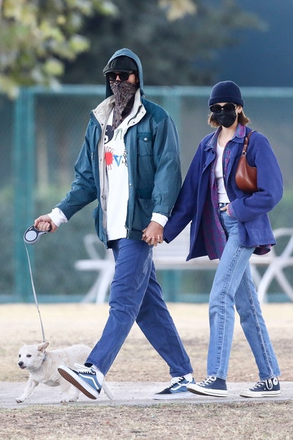 Happy couple Kaia Gerber and Jacob Elordi hold hands as they take Kaia's adorable puppy to a dog park on a Friday afternoon.