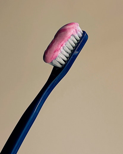 A blue toothbrush with pink toothpaste. Apple partnered with female photographers for an International Women's Day photo series about gender shot on iPhone 12.