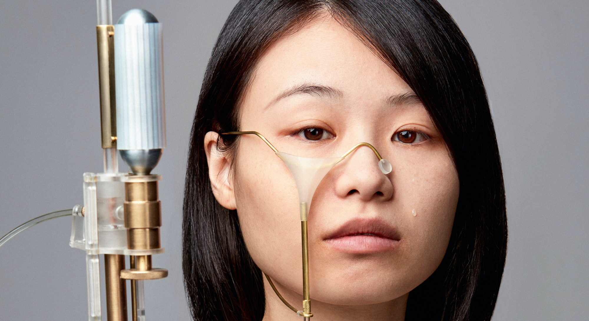 Taiwanese artist Yi-Fei Chen is seen holding a tear gun.