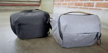 An Amazon bag is next to a Peak Design bag.