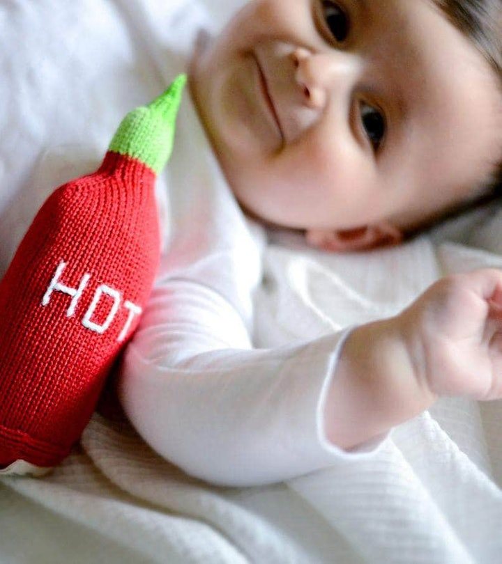baby with hot sauce rattle