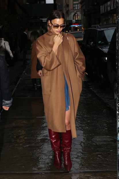 Irina Shayk is spotted leaving her hotel on Sunday. The brunette model and mother bundles up in a camel long line coat as she heads out for the evening.