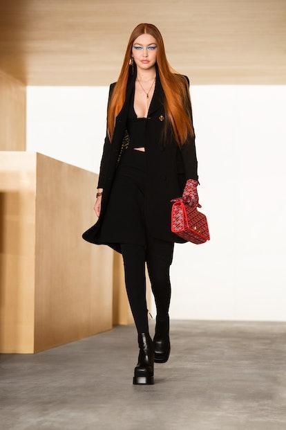 Gigi Hadid opens the Versace Fall/Winter 2021 show.