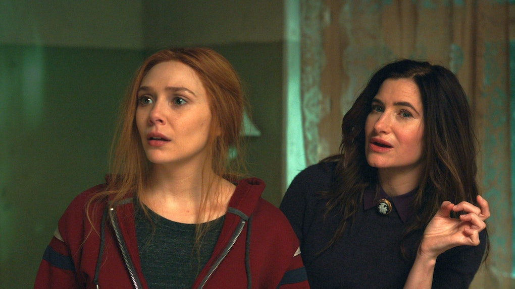 Elizabeth Olsen as Wanda Maximoff and Kathryn Hahn as Agatha Harkness in WandaVision.