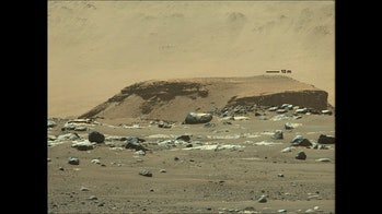 an outcropping of rocks on Mars with evidence of sedimentary layering