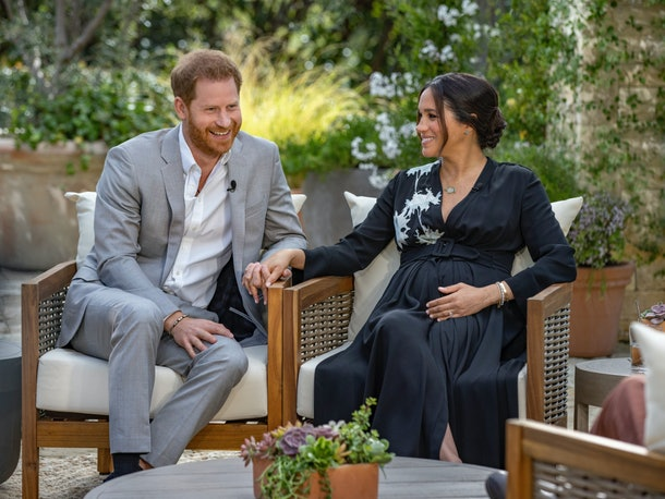 Prince Harry and Meghan Markle hold hands and laugh during their interview with Oprah Winfrey.