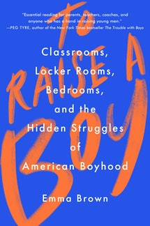 """The cover of 'To Raise a Boy"""", bright orange font on a blue background."""