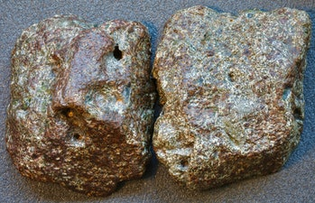 A picture of two meteorite chunks next to each other