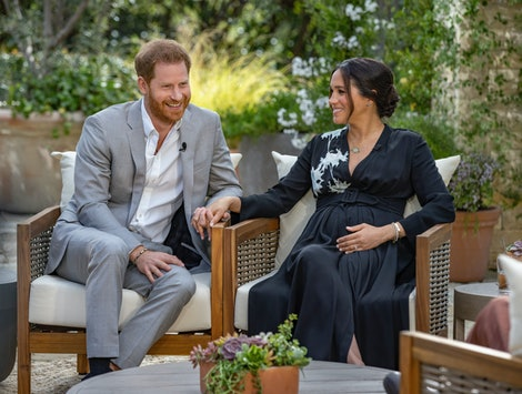 Prince Harry and Meghan Markle hold hands during their interview with Oprah Winfrey.