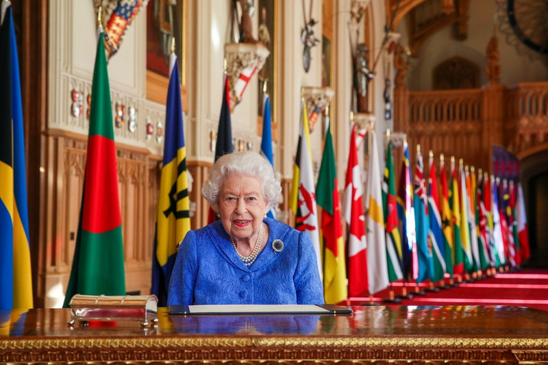 Queen Elizabeth II signs her annual Commonwealth Day Message in St George's Hall at Windsor Castle
