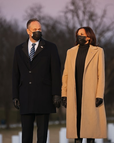 Vice President-elect Kamala Harris (R) and her husband Douglas Emhoff (L) arrive for a ceremony to honor the nearly 400,000 American victims of the coronavirus pandemic at the Lincoln Memorial Reflecting Pool January 19, 2021 in Washington, DC. As the nation's capital has become a fortress city of roadblocks, barricades and 20,000 National Guard troops due to heightened security around Biden's inauguration, 400 lights were placed around the Reflecting Pool to honor the nearly 400,000 Americans killed by COVID-19.