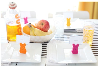 Easter table setting with pink, orange, and yellow Peep bunny place card holders