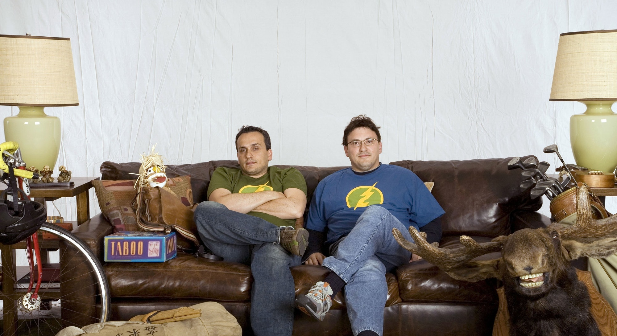 Russo Brothers on a couch
