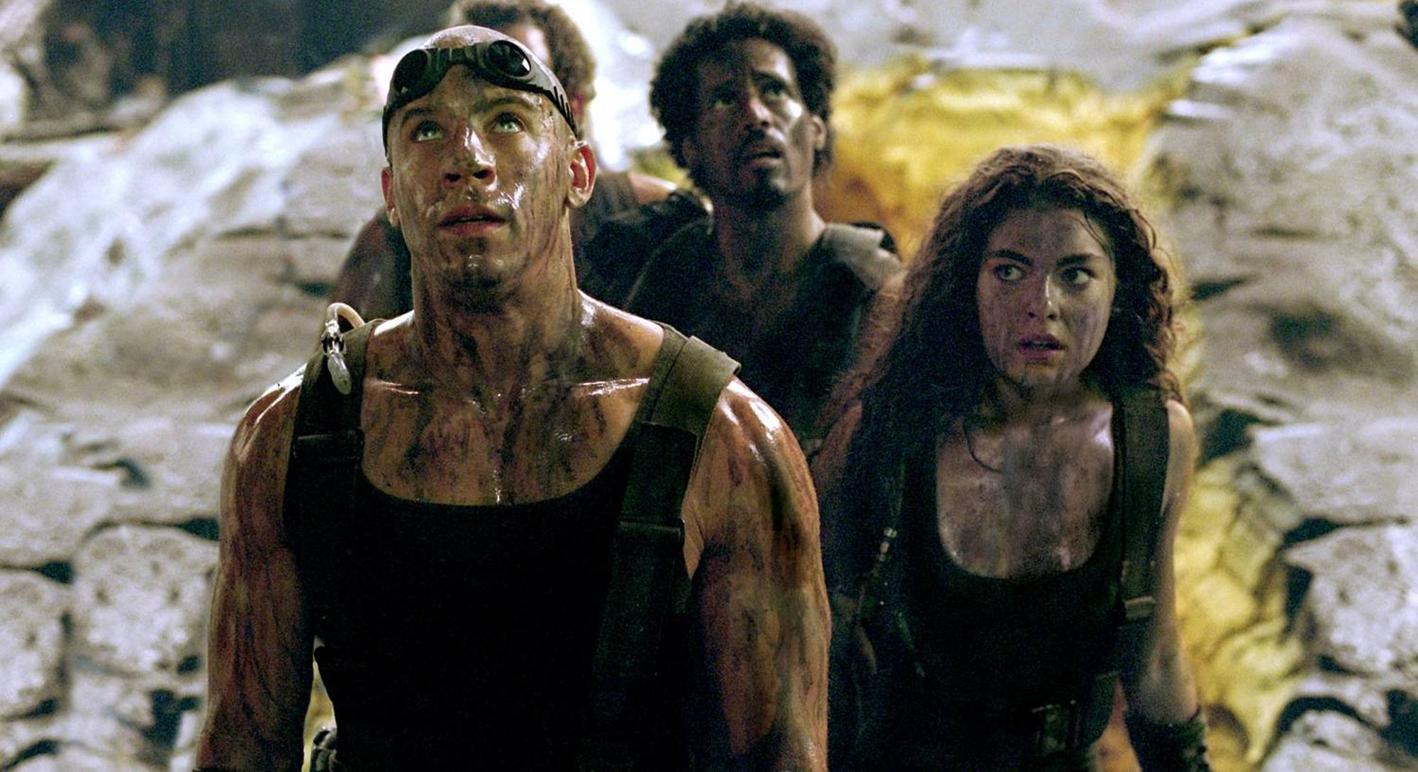 vin diesel with goggles on head looking up in chronicles of riddick
