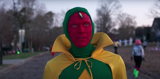 Vision walks through the neighborhood in his Halloween costume in 'WandaVision.'