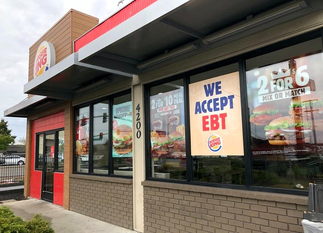 A Burger King in Oakland, Calif. advertising that it accepts benefits issued to low-income families ...
