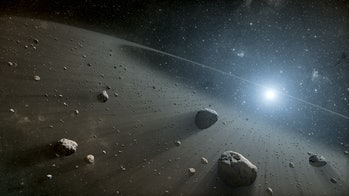 An image of asteroids circling a bright star