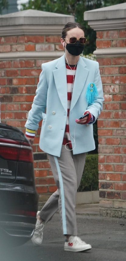 Actress and filmmaker Olivia Wilde dons her light blue suit jacket, sunglasses and wears her protective face mask due to the ongoing threat for the Coronavirus as she grabs a coffee out in West London.