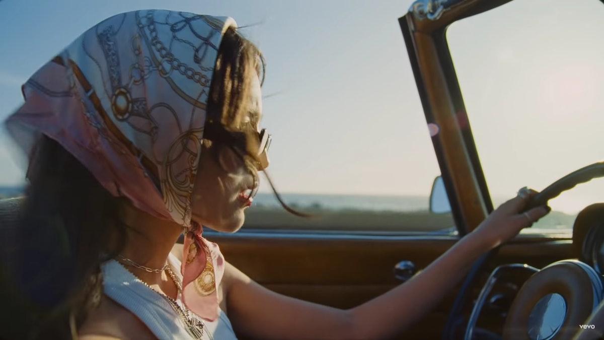 "Olivia Rodrigo driving in the ""Deja Vu"" music video."