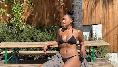 Tracee Ellis Ross wearing a black bikini.