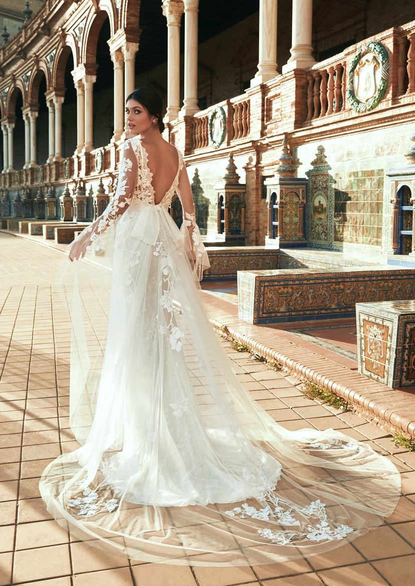 Model wearing a wedding dress from the Marchesa for Pronovias spring 2022 bridal collection.