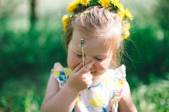 close up of happy toddler wearing a flower crown