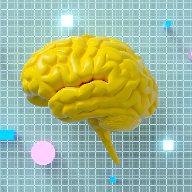 Yellow brain with grid and colorful shapes