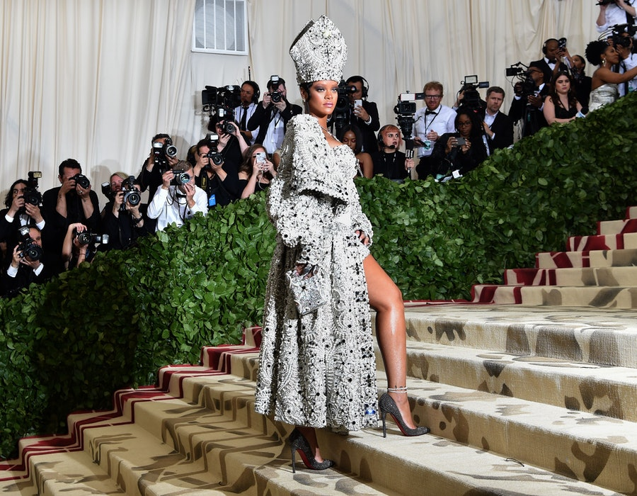 Rihanna arrives for the 2018 Met Gala on May 7, 2018, at the Metropolitan Museum of Art in New York. - The Gala raises money for the Metropolitan Museum of Arts Costume Institute. The Gala's 2018 theme is Heavenly Bodies: Fashion and the Catholic Imagination.