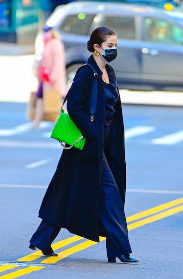 Selena Gomez crossing the street