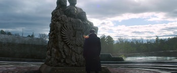 Daniel Brühl as Baron Zemo in front of Sokovia monument in The Falcon and the Winter Soldier
