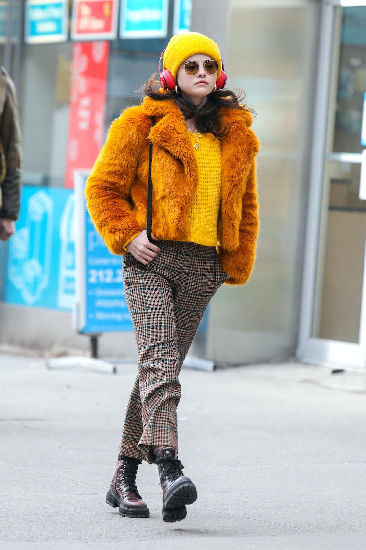 Selena Gomez wearing orange and yellow