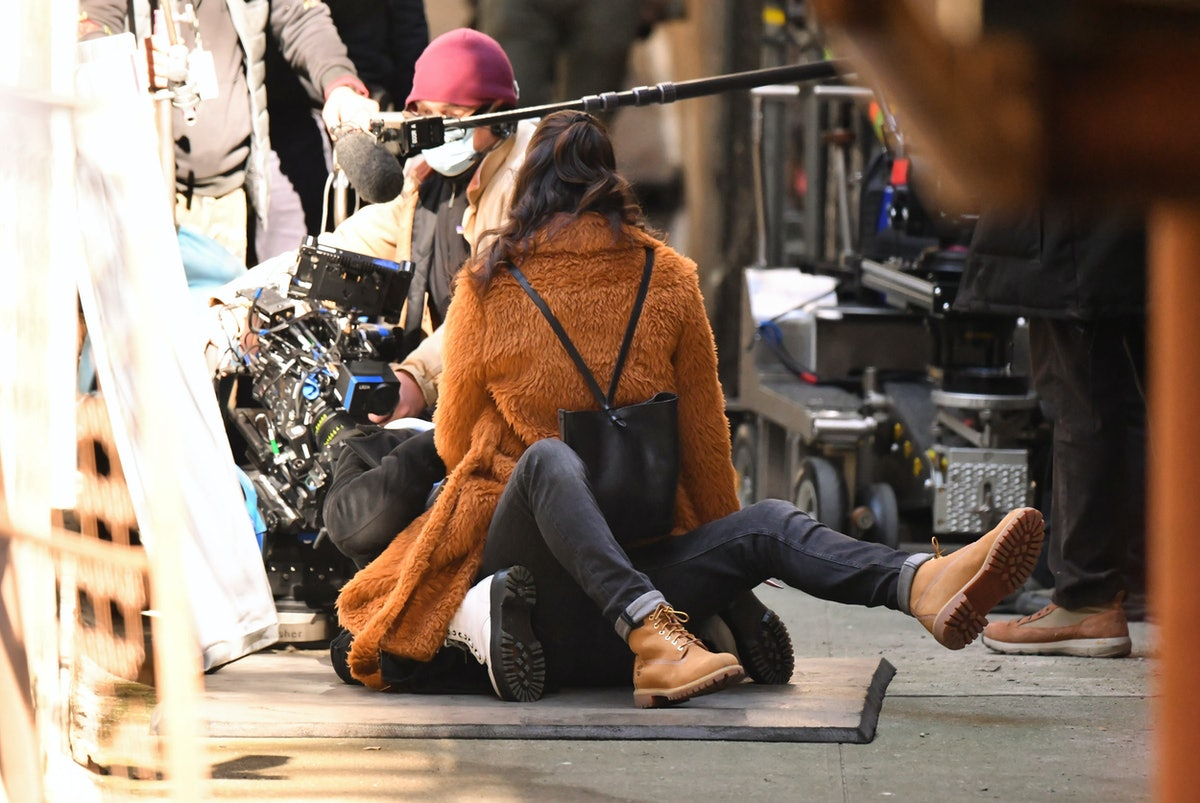 Selena Gomez straddling someone