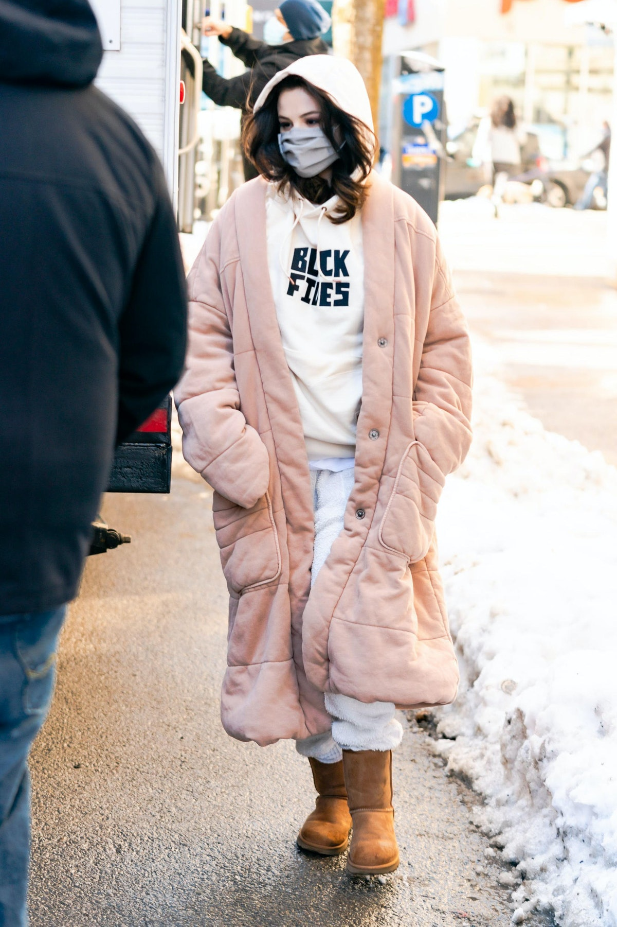 Selena Gomez in a long pink coat