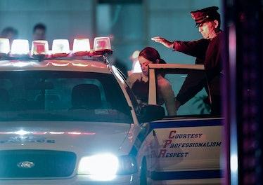 Selena Gomez ducking into a police car