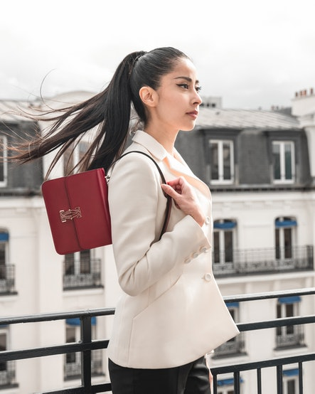 Model with Cartier's Double C de Cartier handbag.