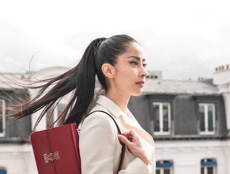 Model with Cartier's Double C de Cartier handbag.
