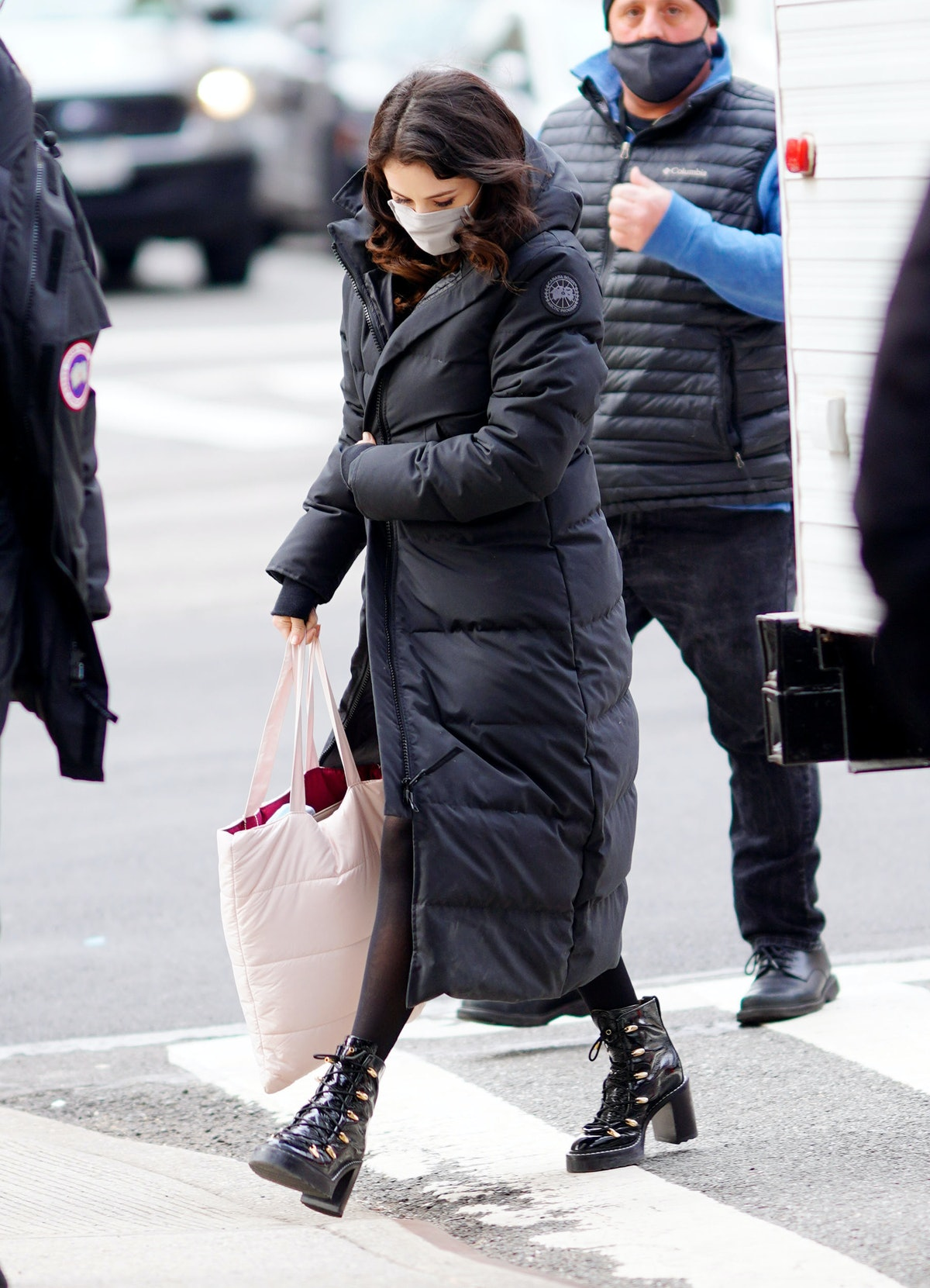 Selena Gomez wearing a long puffer coat