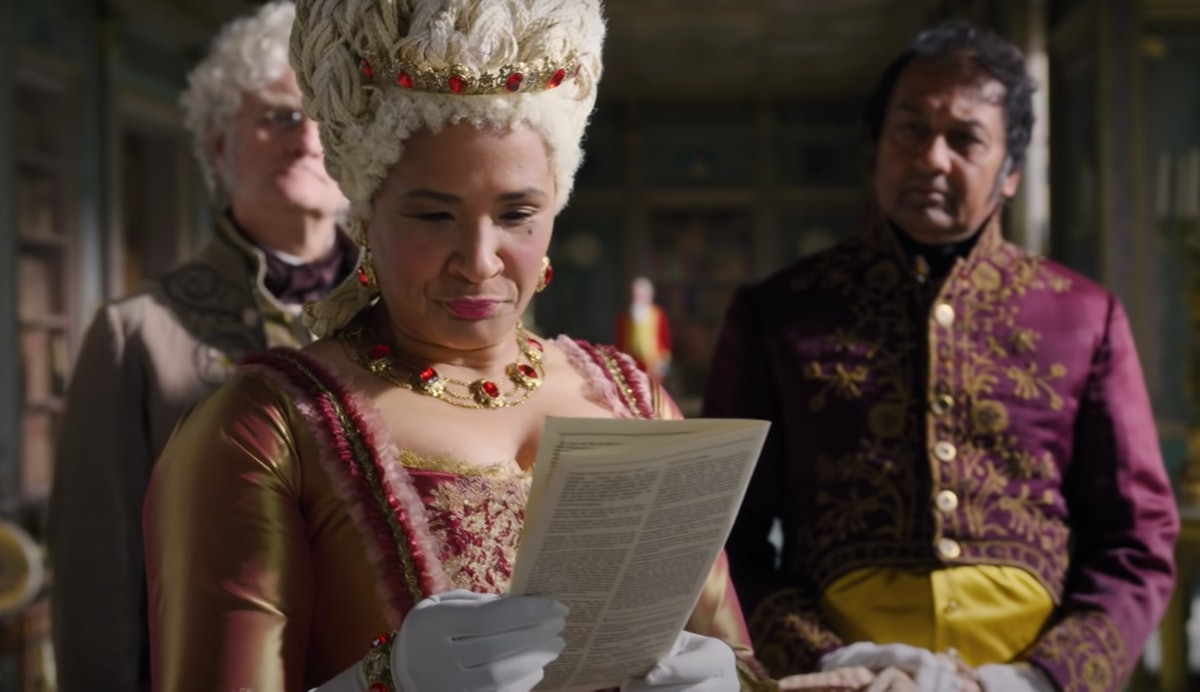 Queen Charlotte from 'Bridgerton' looks at one of Lady Whistledown's papers.