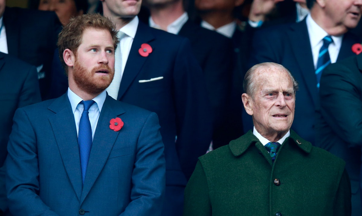 LONDON, ENGLAND - OCTOBER 31:  Prince Harry, Prince Phillip and Prince William stand for the nationa...