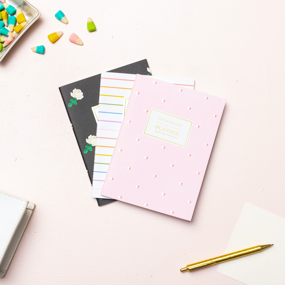 Three notebooks from The Home Edit for Day Designer collection lay on the table.