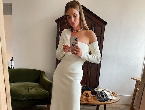 Rosie Huntington-Whitely in a white dress.