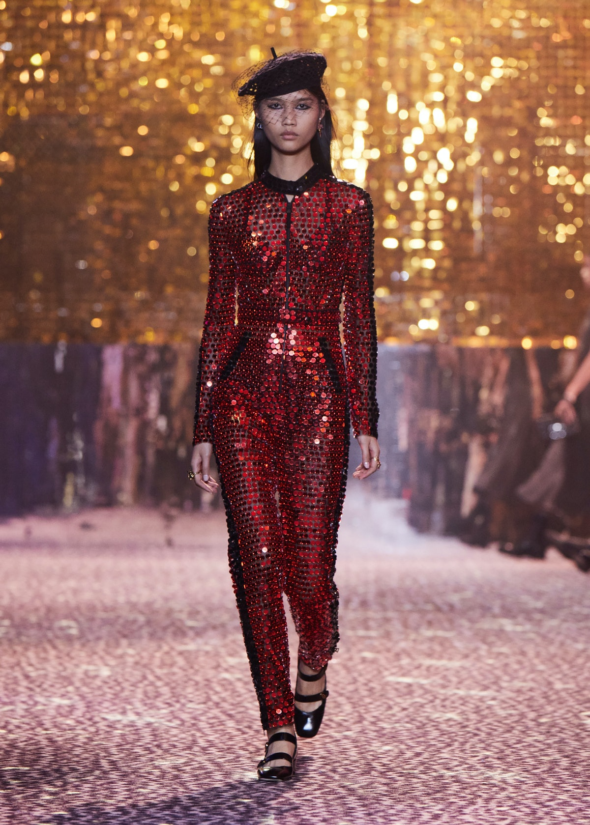 Model in red sequined bodysuit