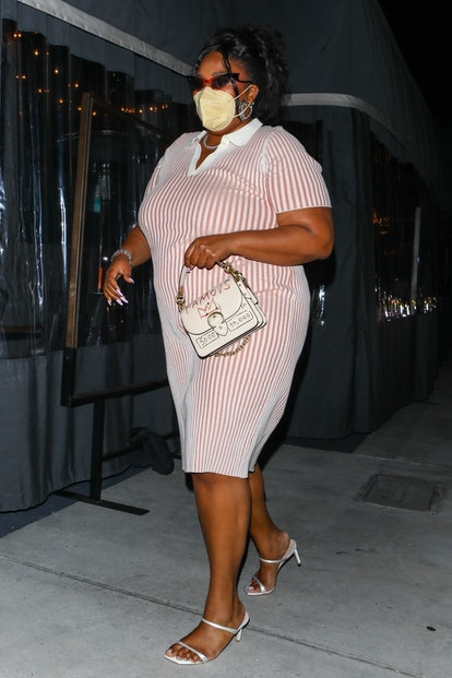 Singer, Lizzo looks stunning in a pink and white striped dress while leaving dinner at Crossroads Kitchen in Los Angeles.