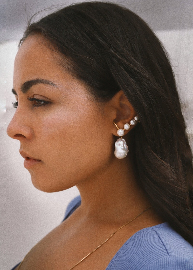 Gabriella Zacche of DYAD wears the Venus Earcuff Earring in Gold — a great birthstone jewelry piece to gift for mother's day and beyond.